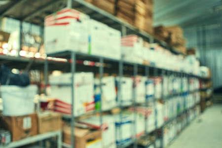 Warehouse shelf for product storage. Logistics. blurred background.