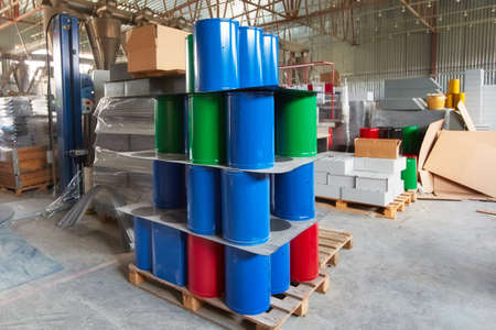 New trash bins are in the shop of the factory for the production of metal products. Blue, green and red metal containers for installation in urban environments and parks