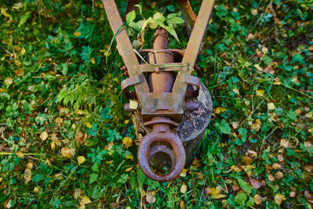 Old and rusty tractor trailer hitch.