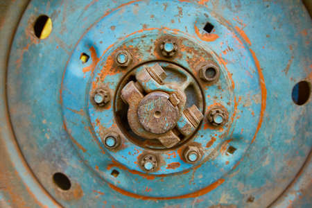 old rusty tractor wheel close up.