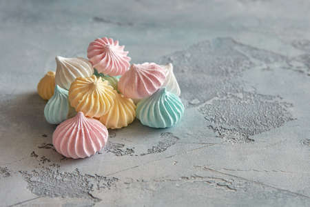 Pastel colored meringue on a beautiful textural background.