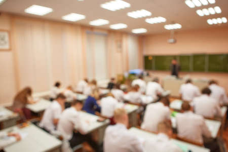 Blur students and teachers in the classroom for background use.