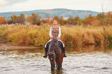 The rider and the horse went into the water to water the horse