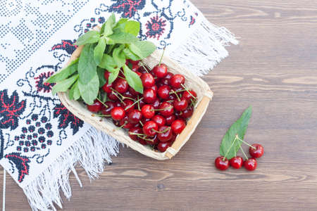 basket embroidery: Fresh cherries and mint on embroidered towel