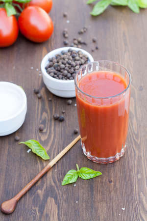 tomato juice: Fresh tomato juice herbs and spices on wooden table