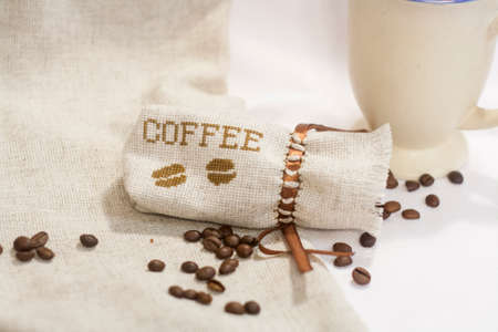 sachet: Sachet with embroidery stitch with coffee beans, selective focus