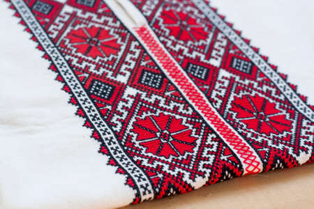 fancywork: Shirt with national Ukrainian embroidered red and black colors, selective focus Stock Photo