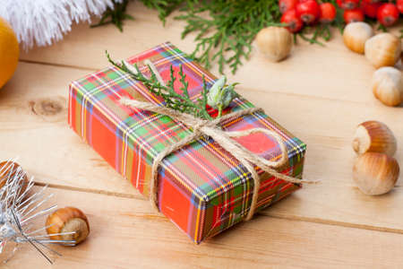 midst: Christmas gift box with New Years and Christmas decoration midst fruits and tinsel.