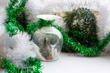Christmas souvenir on background holiday decoration. White and green scale.