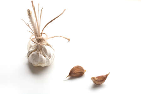 natural background: Heads of young and mature garlic, and raw cloves of garlic isolated on a white background. Stock Photo