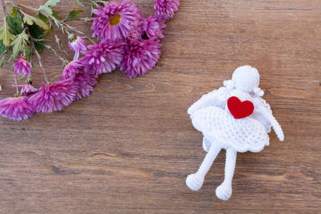 Valentines day hearts and angel and flowers on wooden table Reklamní fotografie