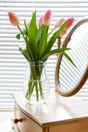 backlight: Beautiful bouquet of pink tulips and mirror on backlight background