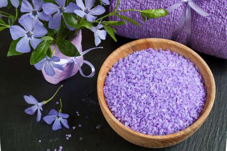 bath salts: Spa products. Lavender bath salts with flowers and towel. Violet purple concept