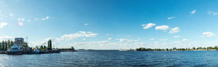 machinery: The water area in Dnieper river harbor.Old ships in the port. Breakwater and lighthouse. Panorama. Stock Photo