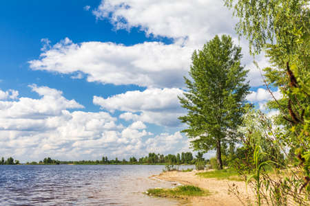 Beautiful summer river landscape with beautiful clouds in the sky.