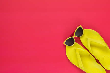 Summer accessories on pink floor. Flat lay, top view vacation background. Stock Photo - 102826715