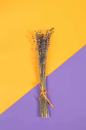 Beautiful dried lavender bouquet on violet yellow surface. Top view, copy space. Nice holiday wedding valentin birthday card.