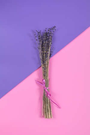 Beautiful dried lavender bouquet on violet pink surface. Top view, copy space. Nice holiday wedding valentin birthday card.