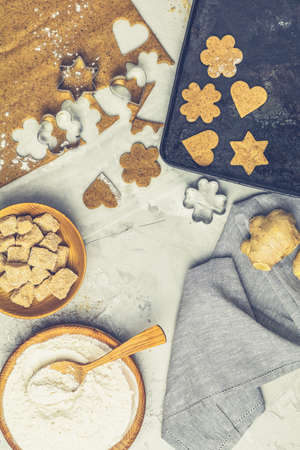 Culinary Spring or Christmas food background. Ingredients for ginger cookies. Dough for baking, brown sugar, flour, eggs. View from above. Stock Photo