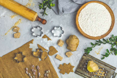 Culinary Spring or Christmas food background. Ingredients for ginger cookies. Dough for baking. View from above. Stock Photo
