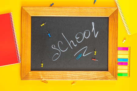 School concept background. Chalkboard with stationery, flat lay, top view, copy space for you text. Stock Photo - 126343713
