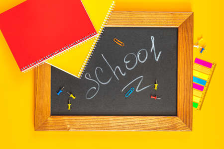 School concept background. Chalkboard with stationery, flat lay, top view, copy space for you text. Stock Photo - 126343716