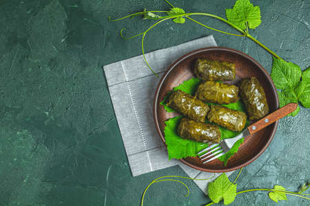 Traditional Middle Eastern dolma or tolma or sarma. Latin American Mexican Chilean cuisine ninos envueltos. Grape leaves stuffed with meat and rice. Lebanon turkish greek middle eastern cuisine. Stock Photo - 126343724