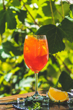 cocktail in big wine glass with oranges, summer Italian fresh alcohol cold drink. Stock Photo - 128302363