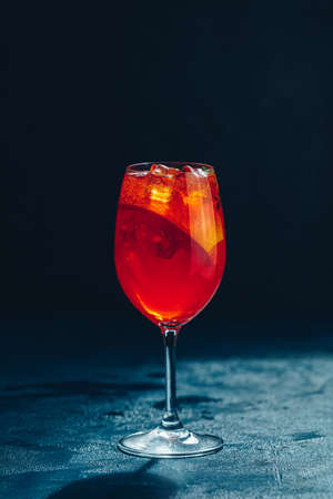 Summer alcohol cocktail with orange slices. Italian cocktail   on slate board. Trendy beverage Stock Photo - 128302611