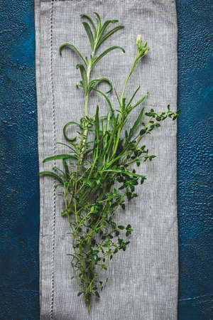 Herbs and spices.Fresh herbs selection included rosemary, thyme, mint, lemon balm and arugula. Overhead view, copy space. Stock Photo - 129770322