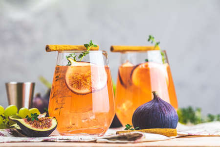 Pink cocktail with fig, thyme, cinnamon and grapes in glass on pink concrete background, close up. Autumn drinks and alcoholic cocktails. Alcoholic cocktail or detox drink Stock Photo - 130485472