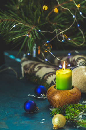 Christmas and New Year composition. Candles and holiday decor, branches of pine and spruce,  bokeh, dark background. 写真素材 - 132822940