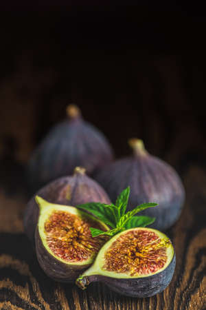 Ripe Fig Fruits on old wooden background. Paleo diet, still life with copy space. Shallow depth of the field. 写真素材