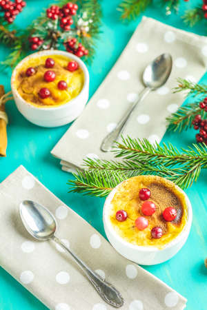 Christmas and New Year composition with sweet delicious apples dessert, spruce branches, cutlery on blue turquoise wooden table surface, copy spice, Holidays background, Christmas table place setting.