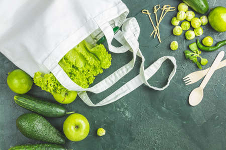 Zero waste concept. Eco-friendly shopping, flat lay. Fresh organic green vegetables and fruits on green background. Spring diet, healthy raw vegetarian, vegan concept, alkaline clean eating Stock Photo - 138714880