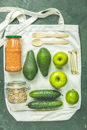 Zero waste concept. Eco-friendly shopping, flat lay. Fresh organic green vegetables and fruits on gray background. Spring diet, healthy raw vegetarian, vegan concept, alkaline clean eating Stock Photo - 138717191