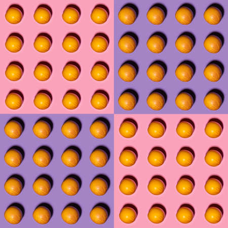Orange pattern on pink and violet background. Creative food concept. Flat lay.