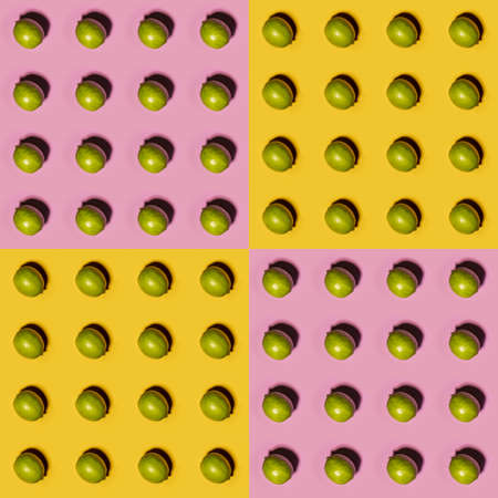 Limes pattern on yellow and pink background. Creative food concept. Flat lay. Stock Photo