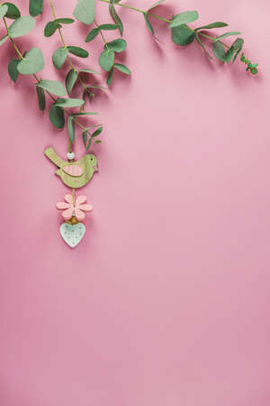 Eucalyptus leaves on pink background. Frame made of eucalyptus branches. Valentine's day, Mother's day, Happy Easter, Womans Day concept. Flat lay, top view, copy space Stock Photo