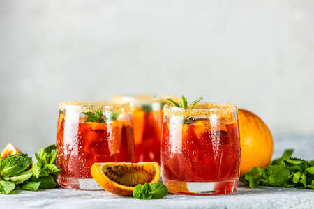 Italian cocktail with orange slices and ingredients on light gray stone table. Summer drink, homemade sangria, Cocktail of sweet. Copy space Stock Photo