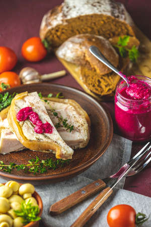 Tasty baking pork lard bacon fatback with black pepper and other herbs and spices in ceramic dish. Traditional Christmas Ukrainian, Hungarian, Polish or other Eastern Europe national dish