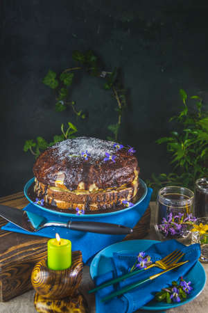Delicious homemade cake served on wooden table. Chocolate cake food photography recipe idea. Selective focus, shallow depth of the field