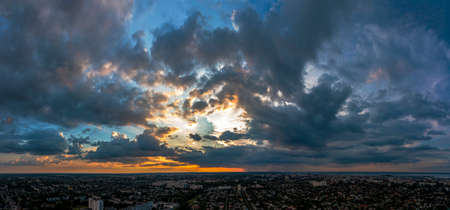 Aerial view from drone. Aerial view amazing sunset over of the suburbs with the city, far villages and fields.