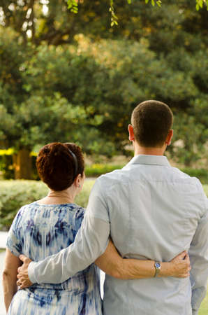 cherishing: Mother and son walking through life together. Stock Photo