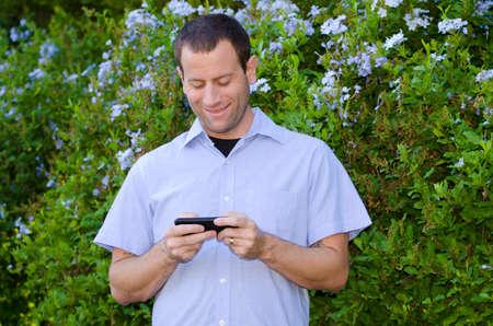 excitement on smartphone. Stock Photo