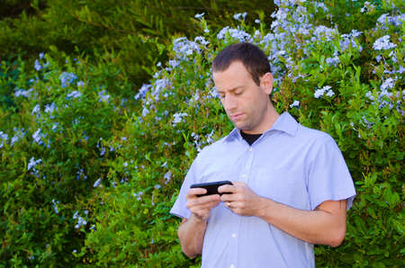 Man on a smartphone playing games. Stock Photo