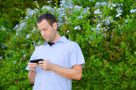 Man on a smartphone playing Pokemon Go.
