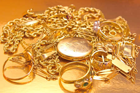 Beautiful rings, necklaces, earrings, pendants and medallions made of real gold,photography Фото со стока