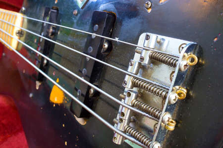 The part of the black bass guitar photo
