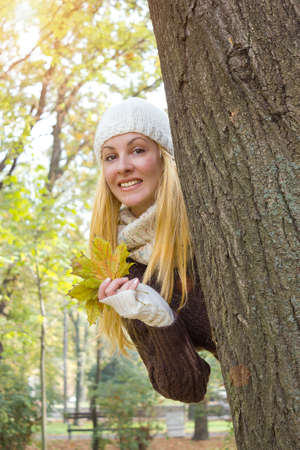 A young woman in the park enjoying the charms of autumn, Autumn, photography photo